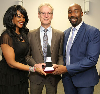 Don Carswell, who accepted the award for his father, Professor Allan Carswell, who was travelling in Africa, is flanked by Gwyneth Matthew-Chapman, left, and real estate businessman, Tosin Bello, who co-sponsored the award.
