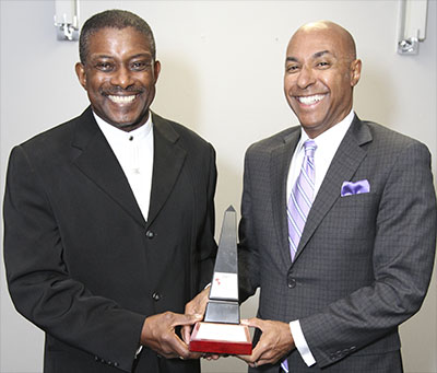The CFL's 13th and first Black Commissioner, Jeffrey L. Orridge, right, accepts his award from ACAA Founder, Michael Van Cooten, who made the presentation on behalf of Paul Wilkins, a Markham lawyer and head of PW Lawyers, the law firm that sponsored the award. Photo credit: Bruce Ramsay