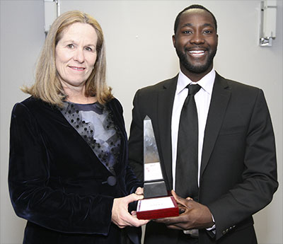 Jennifer Tory, Group Head, Personal and Commercial Banking at RBC, which sponsored the Young Achievers Award of Excellence, presents it to Remi Ojo Jr.