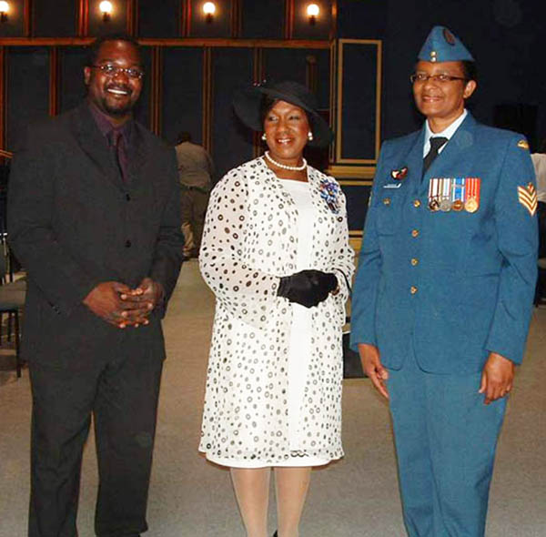 Retired Sergeant Joan Buchanan, Military Co-Chair of the Defence Visible Minorities Advisory Group Atlantic Region with Civilian Co-chair, Henri-Thierry de Souza, left, and then-Lieutenant-Governor of Nova Scotia, the Honourable Mayann Francis, in July 2009 at the # 2 Construction Battalion Ceremony in Halifax, Nova Scotia. Photo credit: ©2009 DND/MDN Canada.