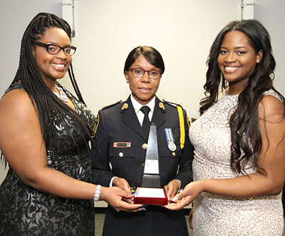 Peel Police Supt. Ingrid Berkeley-Brown, centre, is flanked by Kayla Benjamin, left, and Sayola Benjamin, who presented the award on behalf of Benjamin Law, a north Toronto law firm that also has an office in Brampton. Photo credit: Bruce Ramsay.