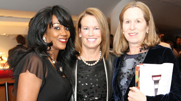Laura Gainey, centre, senior vice president, Service and Operations, RBC Insurance, mingles with Gwyneth Matthew-Chapman, left, and Jennifer Tory, before presenting $150.00 to Kiera Allum-Rowe as part of RBC's Make 150 Count program. Photo credit: Bruce Ramsay.
