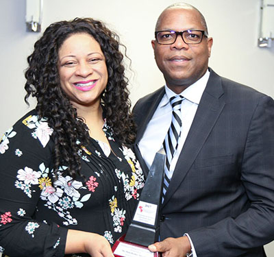 Mykella Van Cooten, the ACAA CEO's eldest child, presents the Excellence in Management and Leadership award to Mark Beckles, on behalf of Formula Honda, its sponsor. Photo credit: Bruce Ramsay.