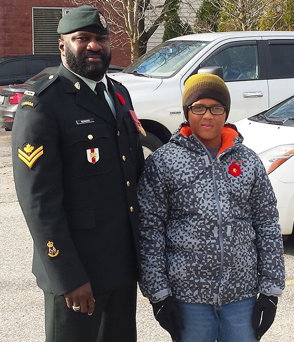 Master Corporal Ezrick Bernard and his 11-year-old son, Maxwell Bernard, in Borden, Ontario on Remembrance Day in 2016. Photo provided by MCpl Bernard.