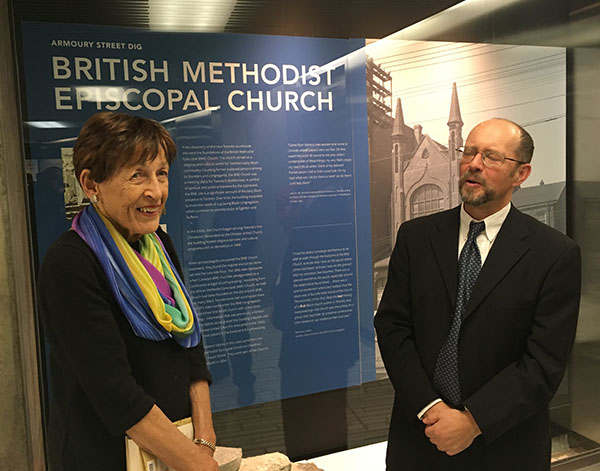 Toronto's first Black female councillor, Bev Salmon, who served when the city was called Metro Toronto, and Wayne Reeves, Chief Curator, City of Toronto Historic Sites, in front of the display about the British Methodist Episcopal Church, an important place for the early Black community in Toronto in the 1800s. Photo credit: Neil Armstrong.