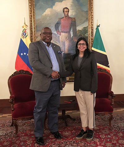 OECS Chair, Dr. Timothy Harris, left, and Delcy Rodriguez, Venezuela's Foreign Minister, greet each other before the start of their recent meeting. Photo contributed.