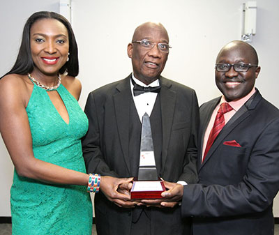 Anthony Joseph, publisher and editor of the Caribbean Camera newspaper, centre, displays his award, while flanked by Moses A. Mawa, right, President and CEO, Silvertrust Media and Afroglobal Television and Patricia Bebia Mawa, Host of Planet Africa, and Vice President for Silvertrust Media and Afroglobal Television. Anthony's award was sponsored by Pride News Magazine. Photo credit: Bruce Ramsay.