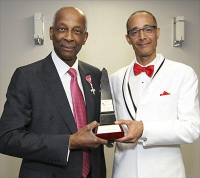 "Dr. Tabo Sikaneta, right, accepts his Excellence in Science award from its sponsor, Obstetrician and Gynecologist, Dr. Lanval ""Joe"" Daly. Photo credit: Bruce Ramsay."