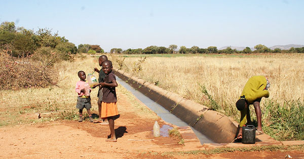 Children fetch water from a canal at the Magwe irrigation scheme in south Matabeleland, Zimbabwe. Photo credit: Busani Bafana/IPS.