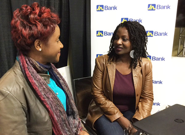 Joan Kelly (right), operator of Starr Treatments in Toronto, a massage and skincare treatment centre, talks business with Carlene Edwards, Sales Promotions and Events Manager, JN Bank, at the JN Group Expo in Brampton, Ontario, recently.