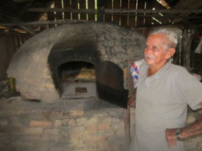 "João Lisboa Sobrinho, 85, a baker from Ilha da Fazenda who ""only"" has ten children. Until recently, he used 50 kg of flour a day to make bread, but now uses just three – a reflection of the decline and depopulation of this island village along the Xingu River, in the northern Brazilian state of Pará. Photo credit: Mario Osava/IPS."