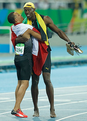 De Grasse and Bolt after running the 100-meter final at the 2016 Olympics. Photo credit: Fernando Frazão/Agência Brasil.