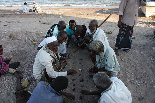 On a beach in Tadjoura locals play a traditional Afar game—Djibouti's population consists mainly of ethnic Somali and Afar—on the sand. Photo credit: James Jeffrey/IPS.