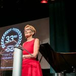 Ontario Premier Kathleen Wynne addresses the audience at the recent ACAA gala, while Michael Coteau, Minister of Children and Youth Services and the Minister Responsible for the Anti-Racism Directorate, looks on. Photo credit: Office of the Premier.