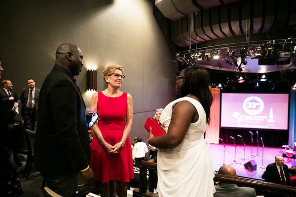 Consul at the Guyana Consulate in Toronto, Mishelle Butters, and her husband, Dwayne, chat with Premier Wynne during intermissio at the ACAA gala. Photo credit: Office of the Premier.