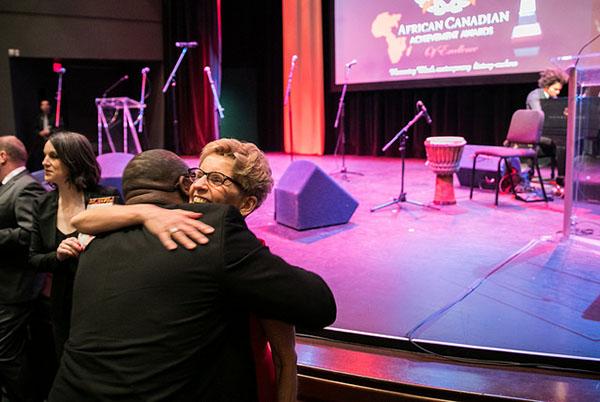 Premier Wynne hugged by fan