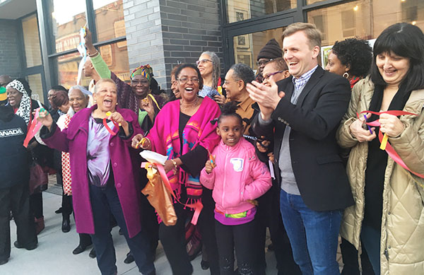 Toronto city councilor, Joe Cressy (Ward 20 Trinity-Spadina) third from right, applauds after helping to cut the ceremonial ribbon to launch A Different Booklist's new location. Photo credit: Neil Armstrong.