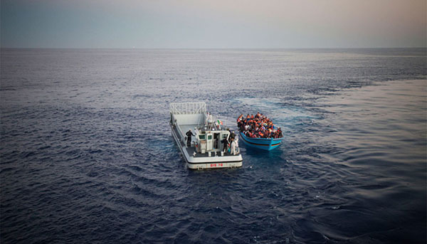 Risking their lives to reach Europe from North Africa, a boatload of people, some of them likely in need of international protection, are rescued in the Mediterranean Sea by the Italian Navy. Photo credit: UNHCR/A. D'Amato.