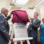 New York City Mayor, Bill de Blasio, third from right, assists Harry Belafonte to unveil plague at the renaming of the 115th Street Library to the Harry Belafonte–115th Street Library. Looking on is Mayor de Blasio's wife, First Lady Chirlane McCray, second from right, US congressman, Adriano Espaillat, right, and other guests, including President of the New York Public Library (NYPL) Tony Marx, who is being shielded in photo. Photo credit: NYC.gov.