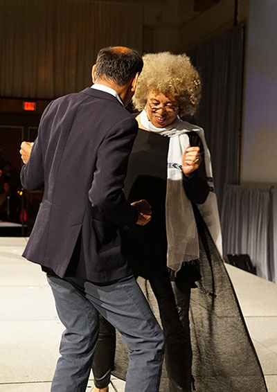 Hassan Yussuff, President of the Canadian Labour Congress, and Angela Davis dancing on stage before her keynote speech. Photo contributed.