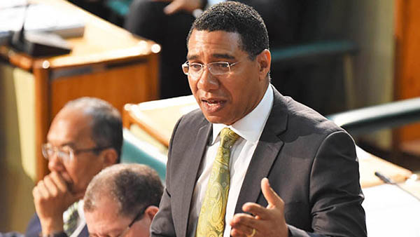 Prime Minister, Andrew Holness, leads the praises for former PM Portia Simpson Miller's long tenure in Parliament. Photo credit: JIS.