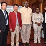 Minister within the Ministry of Natural Resources, Simona Broomes (third from right) and Acting Commissioner of the Guyana Geology and Mines Commission (GGMC), Newell Dennison (centre) pose with the delegation of Chinese businessmen.