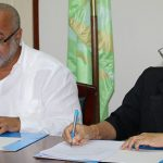 OECS Director General, Dr. Didicus Jules (left), and UNICEF Representative, Khin-Sandi Lwin, seen signing the agreement  on Monday.