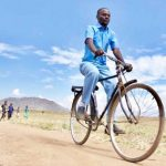 Health Surveillance Assistant (HSA), Noah Chipeta, rides his bicycle from the Chanthunthu community clinic to the nearest health centre, which is 17 kilometres away, in order to restock medical supplies at the clinic in rural Kasungu District, Malawi. Photo credit: UNICEF.