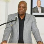 Guyana's Minister of State, Joseph Harmon addresses the media in a recent press briefing.