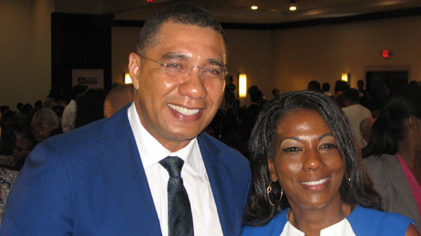 PM Holness shares a light moment with a female member of the audience during a break at the Opening Ceremony, which was held at the Jamaica Pegasus Hotel. Photo by Michael Van Cooten.