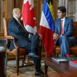 Antigua's non-resident High Commissioner to Canada, Sir Ronald Sanders (left) in conversation with Canadian Prime Minister Justin Trudeau.