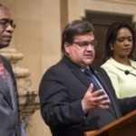 Mayor of Montreal, Denis Coderre (center), flanked by Haitian Ministers, Antonio Rodrique and Stéphanie Auguste.