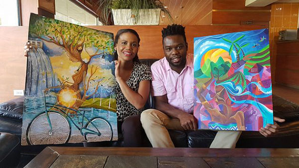 Second- and third-place winners, respectively, in the Caricom Energy Month Photography and Art competition, Candice Sobers and Seon Thompson, holding the works that won them the prizes. Photo credit: Jewel Fraser/IPS.