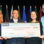 Neil Kolton, Director of Interval International (second from left), presents a donation to the Foundation at Caribbean Travel Marketplace earlier this year. At left is Nadine Rankin, Vice President of the Foundation; and at right is Karolin Troubetzkoy, CHTA President and Ernest Dwight, Chair of the Foundation's Auction Committee.