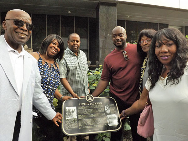 Mark Brown , the author (third from right), seen with descendants of Albert Jackson at the recent unveiling of the plague that commemorates his life.