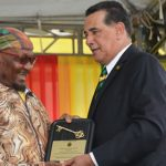 Reggae singer, Jimmy Cliff (left), receives the Key to the City of Montego Bay from Mayor, Homer Davis, at an Independence Day ceremony in Sam Sharpe Square, Montego Bay, on August 6. Photo credit: Garwin Davis/JIS.