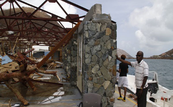 Commissioner of Customs, Aubrey Forbes, surveying the damage done to his workplace. CMC photo.