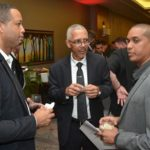 Guyana's Minister of Business, Dominic Gaskin (centre), C.E.O of GOINVEST, Owen Verwey (left) and Trade Commissioner of the Canadian High Commission, Anand Harrilall, engaged in conversation. Photo courtesy of GINA.