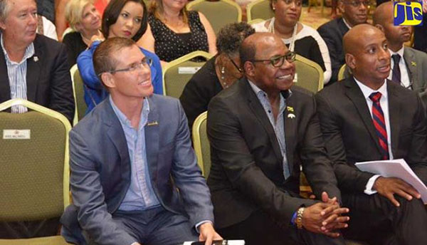 Tourism Minister, Edmund Bartlett (centre), seems pleased with proceedings at the opening of the 27th annual Jamaica Product Exchange (JAPEX), at the Montego Bay Convention Centre, in St. James on September 24. With the Minister are: President of the Jamaica Tourist and Hotel Association (JHTA) Omar Robinson (right) and Chief Executive Officer of Sandals Resorts, Adam Stewart. Photo credit: JIS.
