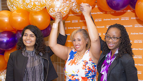 A victorious Nikki Clarke (centre) celebrates with friends, Adaoma Patterson (right), President of the JCA and guest speaker at the nomination meeting, and Sarah Singh. Photo credit: Roy Castereras.