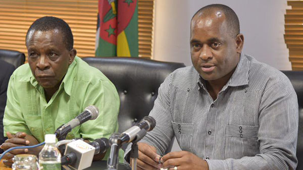 Dominica's Prime Minister, Roosevelt Skerrit and CARICOM Chair, Dr. Keith Mitchell, answer questions at a news conference.