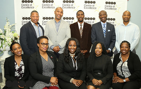 The BBPA's newly elected Board members are (from left to right): front row -- Tisha Reid, Marcia Bowen, Nadine Spencer, Michelle Richards and Frances DelSol; back row -- Roderick Brereton, Andray Domise, Leo Campbell, Osborne Barnwell, Kurt Henry. Photo by DSI Fun Photos.