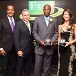 Minister without Portfolio in the Ministry of Economic Growth and Job Creation, Dr. Horace Chang (right), shares a photo opportunity with (from left) Managing Director of the Factories Corporation of Jamaica (FCJ), Dr. Donald Farquharson; FCJ Chairman, Lyttleton Shirley; President of the Jamaica Manufacturers Association (JMA), Metry Seaga; FCJ long-service awardee, Dexter Hunter; and client of the agency and Managing Director of King Pepper, Christine Wong. Occasion was the FCJ's 30th Anniversary Awards Banquet held on October 21 at The Jamaica Pegasus hotel in New Kingston. Photo credit: Michael Sloley/JIS.