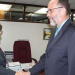 CARICOM Secretary General, Irwin LaRocque, right, greets newly appointed Canadian Ambassador to CARICOM, Lilian Chatterjee.