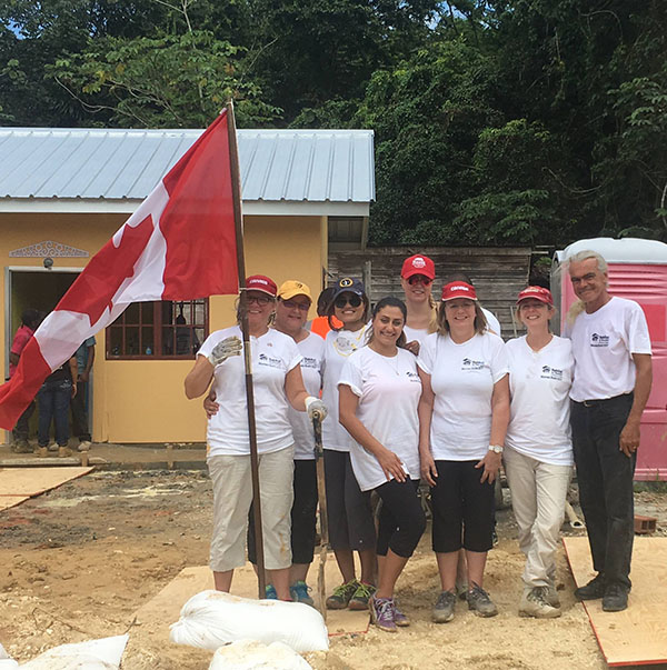 Chantal Keshwah (third from left, in dark blue cap and sun glasses) hangs out with some Canadians in Sangre Grande, the largest town in northeastern Trinidad, in Trinidad and Tobago.  Photo contributed.
