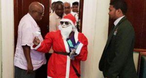 """""""Santa Claus"""" Disrupts Sitting Of Guyana Parliament"""