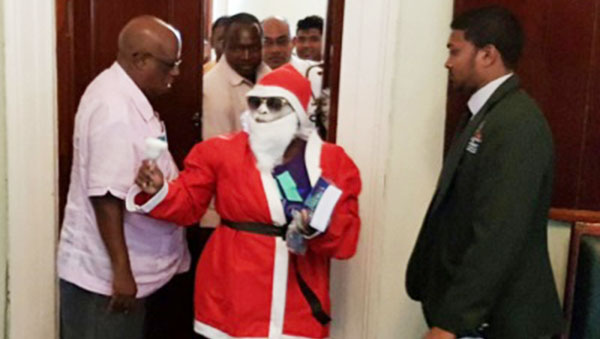 """Santa Claus"" Disrupts Sitting Of Guyana Parliament"