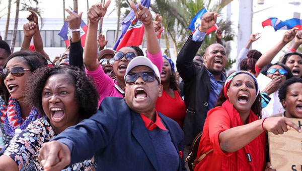 Haitian Protesters Voice Outrage Over Trump's Reported Racist Remarks