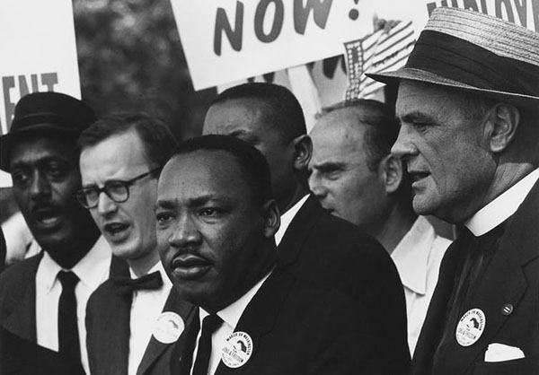 MLK day is a reminder to honour the voices of our past. Dr. Martin Luther King Jr. is seen here at the Civil Rights March on Washington, D.C. (Rowland Scherman; restored by Adam Cuerden - U.S. National Archives and Records Administration), CC BY-NC.