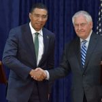 Prime Minister, Andrew Holness (left) and United States Secretary of State, Rex Tillerson, shake hands, following a joint press conference at the Office of the Prime Minister, yesterday (Feb. 7). Photo credit: JIS.